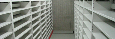 A picture of shelving stacks for storage of negative microfilms