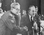 "Japan Socialist Party Right Faction Chairman KAWAKAMI Jotaro (left) shaking hands with Left Faction Chairman SUZUKI Mosaburo (right), with post of new Chairman of unified Party being taken by SUZUKI. From ""Mainichi Gurafu no.285"""