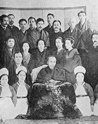 In commemoration of his full recovery after a major operation following the bombing attempt on his life, OKUMA Shigenobu is shown surrounded by close family members and nurses at the Foreign Minister's Residence From (Okuma Haku 100wa)